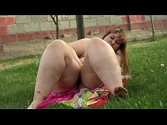 A fat girl smokes in nature and masturbates her pussy and an ass
