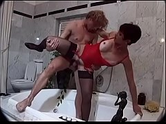 Brunette wildly fucked in the bath tub