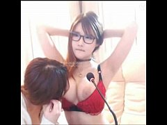 Korean lesbian camgirl in glasses and red bra gets tits licked