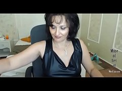 GILF in leather on webcam