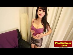 Thai shemale beauty plays with her cock