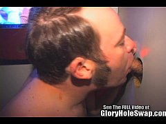 Horny ginger Skyler blowing men in the gloryhole