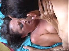 Beautiful mature babe Margo enjoys a big facial cumshot