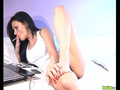 Sexy brunette fucks dildo on live cam