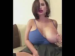 Exquisite busty woman alone on webcam. Does anyone know who it is?