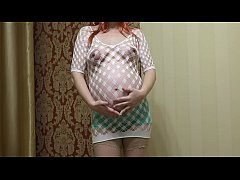 Pregnant milf in stockings and in a frank dress pushes her panties and fucks hairy pussy.