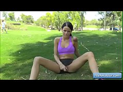 Hot brunette amateur Mya fucks her pussy with a glass dildo on the golf course