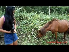 HD asian thai teen peeing next to horse outdoor