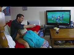 Fucking the blonde girlfriend in the ass while watching football match