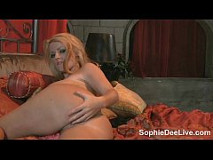 Slutty Sophie Dee teases with her big jugs and masturbates on web cam for you!