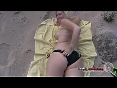 Bikini beach teen girl flashes pussy in the sand