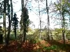 Mature sucks a guy while walking in the forest