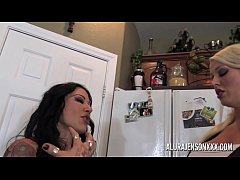 Two lesbian pornstars with huge tits fuck with toys in the kitchen