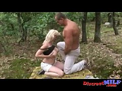 Fat milf going wild in the forest with some guy