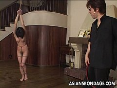 Living room body whipping for the tied up bitch