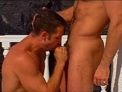 Gorgeous muscled studs engaging in hardcore anal stretching