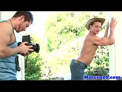 Muscular gay model jerking with photographer