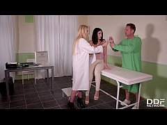 Fetish clinic threesome shows submissive Annie Wolf licking mistress Angel Wicky's pussy