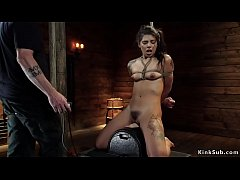 Tattooed slave rides Sybian on hogtie