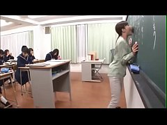 Japanese teacher gives a valuable lesson at the blackboard