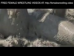 Girls wrestling in the mud