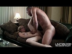 geeky blonde moans with pleasure while guy pounds her in bed