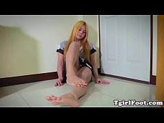 Oriental TS twirling her tiny toes