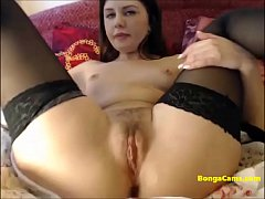 Huge dildo into the tight hairy pussy