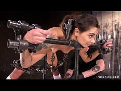 Hot brunette slave in device bondage gets nipples clamped