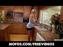 Curvy busty blonde fucks her pink pussy in the kitchen