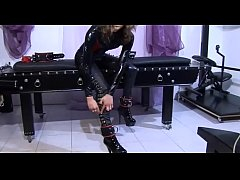 Bondage and high boots for a sexy slave