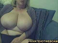 Big blond milf with huge tits masturbating on webcam www.privatehotwebcams.com