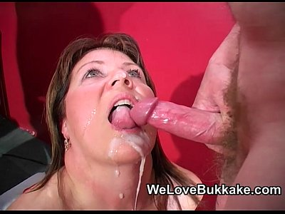 British Bukkake Facial video: Shooting cumshots into mature womans mouth