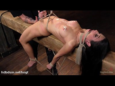 Brunette slave spanked, punished and brought to...