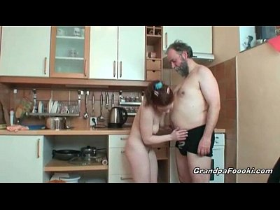 Old Redhead Babe video: Hot redhead rides cock in kitchen