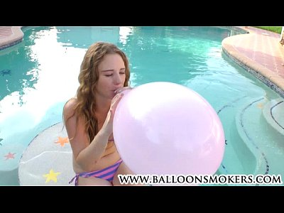Bikini Blow Busty video: Busty teen blows to pop balloons outside in pool