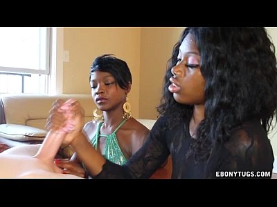 Interracial Ebony video: Two Ebonies Jerk Off A White Cock
