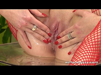 European Pee Peeing video: Wetandpissy Rubbing her big tits in a pool of piss