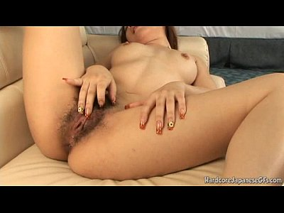 Japanese Hottie Rubbing Her Hairy And Wet Pussy