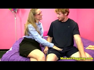 Blonde Handjob Wanking video: Blonde spex milf wanking his hard cock