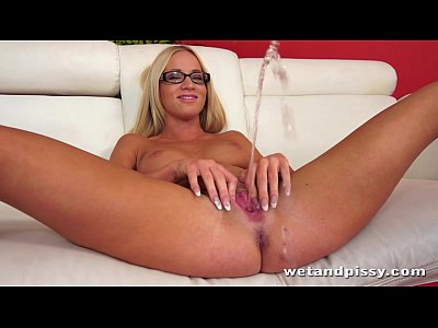 Pretty blonde in glasses uses a jelly dildo on her wet pussy to orgasm