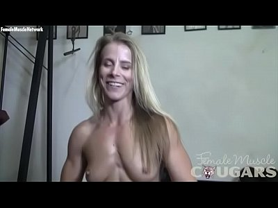Naked female bodybuilder cougar Claire in schoolgirl plaid panties