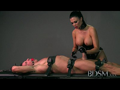 Bdsm Domination Slave video: BDSM XXX Sexy Mistress loves teasing her sub boys hard cock while hes handcuffed
