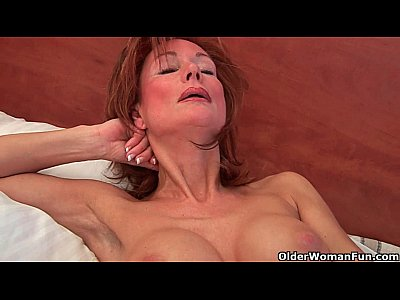 Grandma Grandmother Granny video: Sultry grandma probes her old pussy with a dildo
