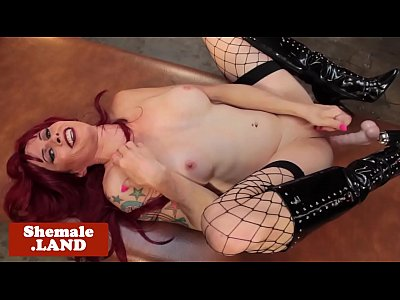Redhead transsexual playing with sextoys