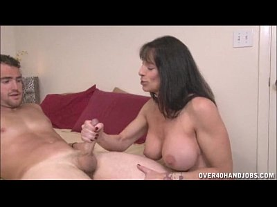 Porno video: Brunette Milf Topless Handjob