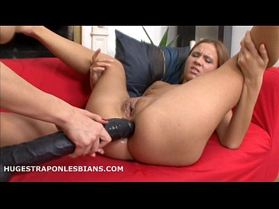 Abby has her tight pussy fucked by Lilian and a huge strapon dildo