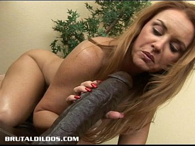 Masturbation Toys video: Busty milf Janet taking every foot of a big brutal dildo