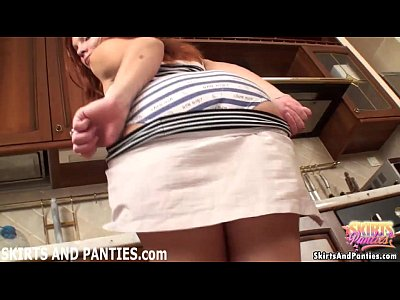 Redhead Britney flashing her stripped panties in the kitchen