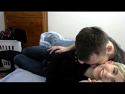 young couple plays in bed casually